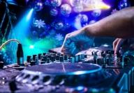 DJ tweaking knobs